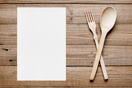 paper sheet: Paper sheet and wooden fork and spoon on table top view Stock Photo