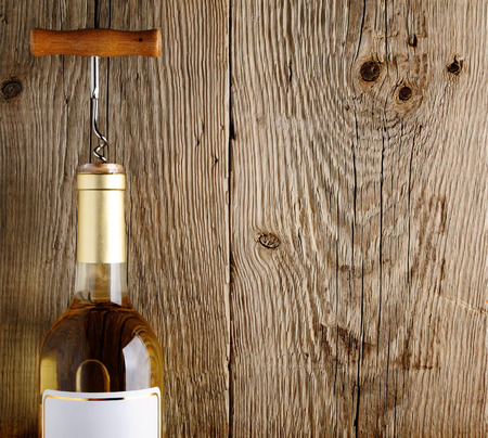 closed corks: Wine bottle on old wooden background Stock Photo
