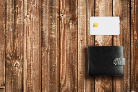 billfold: Leather wallet and credit card mock-up on wooden table Stock Photo