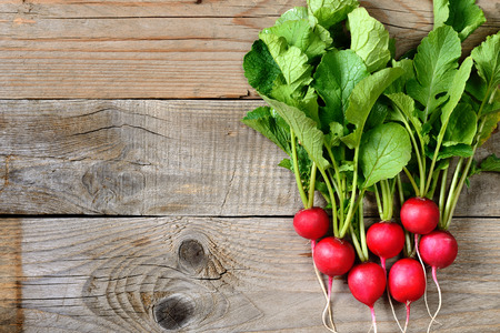 radishes: Fresh radishes on wooden table top view
