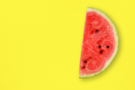 table top: Watermelon slice on yellow table top view Stock Photo
