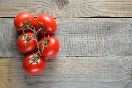 table top: Tomatoes on wooden table top view Stock Photo