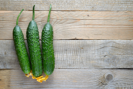 table top: Cucumbers on wooden table top view
