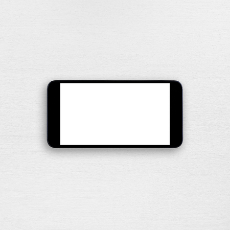 hp: Smartphone with blank screen on white table. Horizontal view Stock Photo