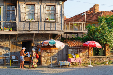 SOZOPOL, BULGARIA - AUGUST 15, 2011: Typical street and house in old town Sozopol. Sozopol is one of popular seaside resorts in Bulgaria.