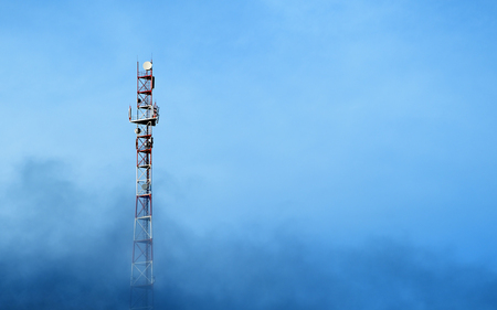 Cell tower on blue sky background