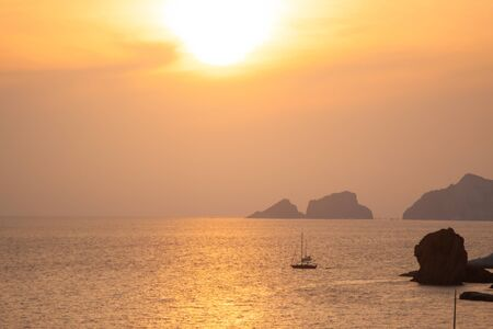 Seascape with boat at sunset in the sea aroudn Ponza island coast. View of the ocean. 9865 写真素材