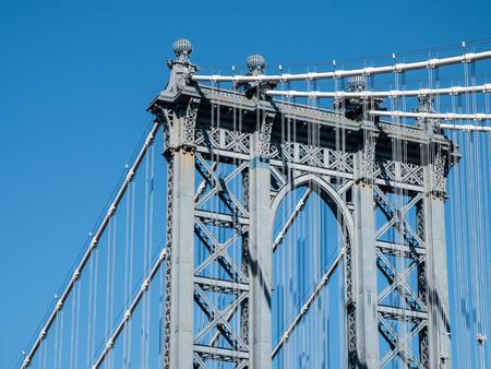 Manhattan bridge seen from road on sunny winter day. New York, USA