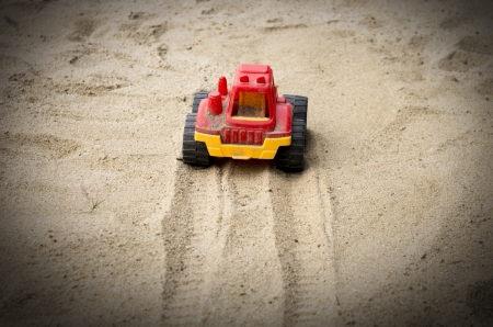 indentation: Sand dirty toy car