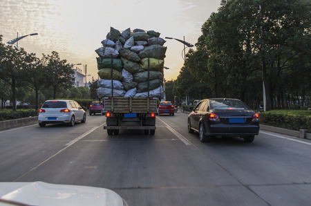overloading: Overloaded truck on road Editorial