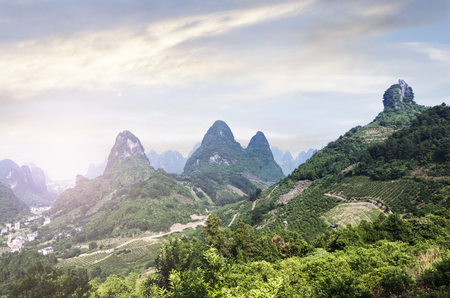 Beautiful karst mountains are visible on blue sky background on summer sunny day. Stock Photo