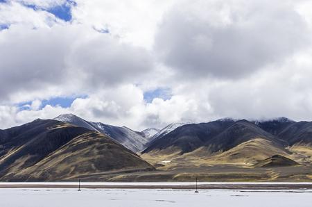 Reflection of saline-alkali land in the Emerald Lake Mountains of Dachaidan