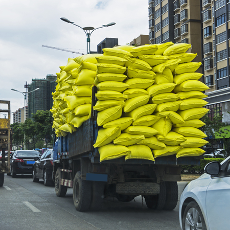 Overloaded truck on road Stock Photo