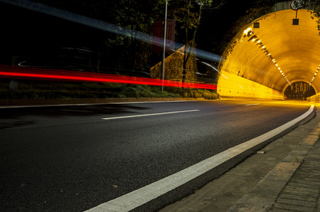 highway road tunnel at night,traffic concept Stock Photo