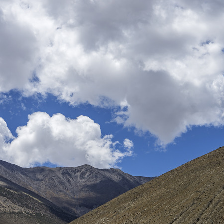 Dangerous mountain road at Ladakh India with view of scenic landscape and Himalayan mountain ranges.