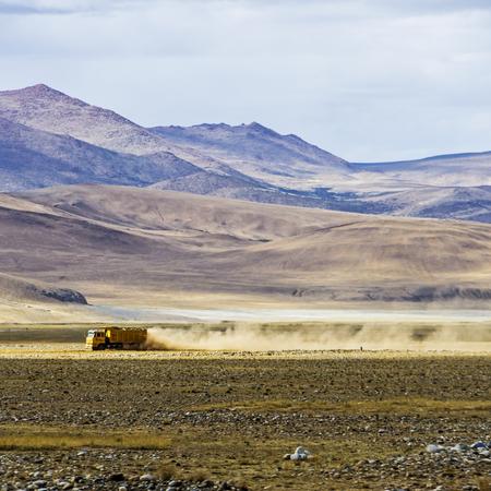 Truck on a desert road Imagens
