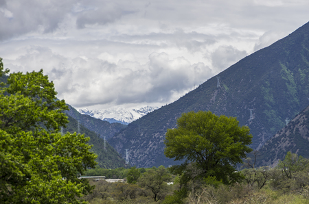 beautiful clouds and fog among frozen mountain summits landscape