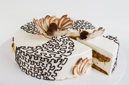 white backing: Cake with openwork tracery and cut a piece Stock Photo