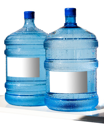 distilled water: Big bottle of water with label isolated on a white background Stock Photo