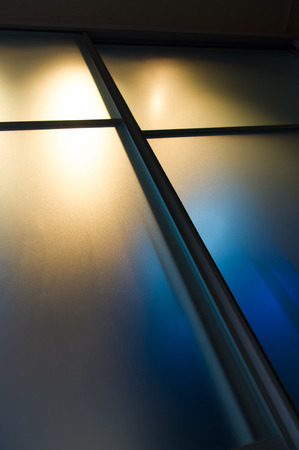 semitransparent: semi-transparent matte glass pane with colored lights, abstract background
