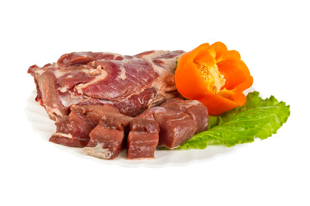 semifinished: semi-finished products made of wild boar meat on the plate - chops, isolated on white background
