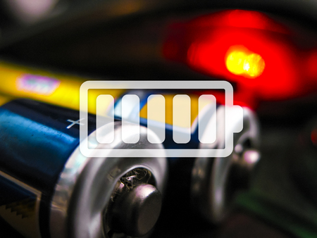 electrolyte: icon charged battery on a colored background Stock Photo