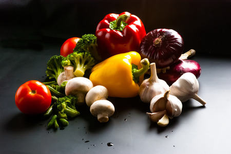 still life - set of pizza on black background - mushrooms, champignons, cauliflower, broccoli, green beans, garlic