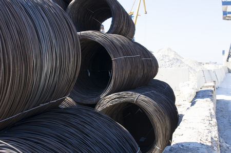 laden: coil reinforcing wire in sea port of Mariupol Stock Photo