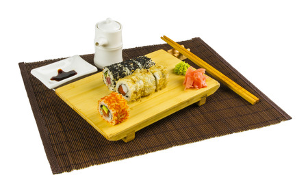 food tray: still life - set the rolls on a board, on bamboo mat, isolated