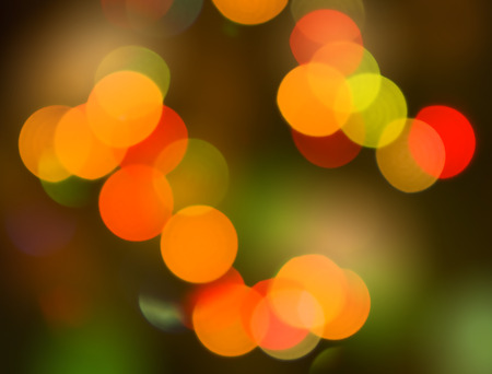 light red: Abstract circular lights blurred bokeh holiday background of Christmas light Stock Photo