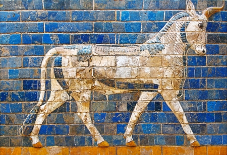 Ancient mosaic on the Ishtar Gate wall with mythical bull, Istanbul museum. Babylonian mosaic, fragment of the Ishtar Gate