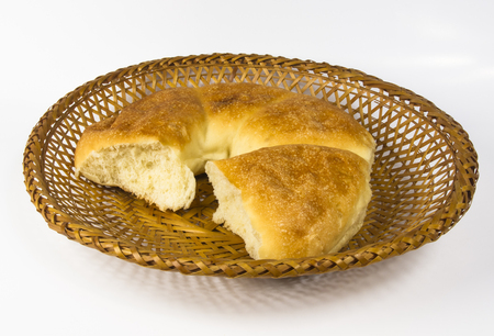rotund: chubby rotund unleavened wheat cake on a wicker plate Stock Photo