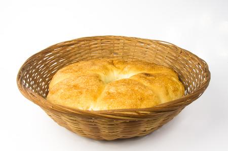 unleavened: chubby rotund unleavened wheat cake on a wicker plate Stock Photo