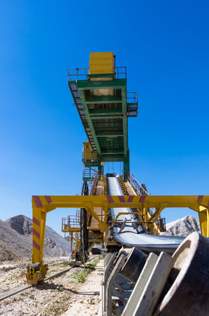 conveyer: conveyer belt in career on extraction of clay on blue sky background