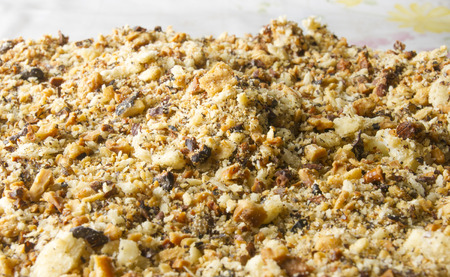 layered big holiday cake sprinkled with walnuts Stock Photo