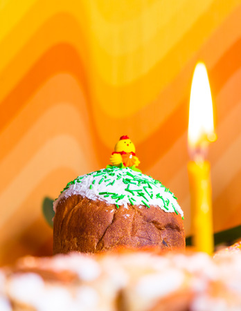 russian easter: Kulichi, traditional Russian Easter cake with icing and candle Stock Photo