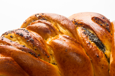 braided: braided poppy seed round loaf on white background Stock Photo