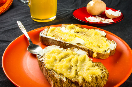 boiled eggs: the bachelor dinner - toast with butter and yellow caviar, boiled eggs and unfiltered beer Stock Photo