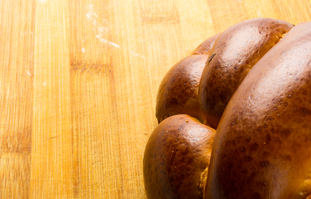 braided: chunks large braided loaf on wooden background Stock Photo