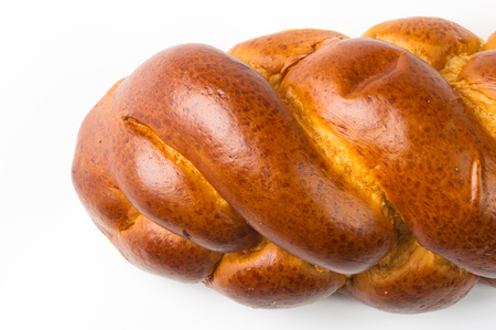 braided: chunks large braided loaf on white background