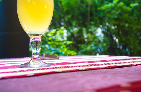 unfiltered: glass of unfiltered beer on colored tablecloths at an outdoor cafe