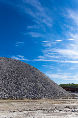 dredging: warehouse production in quarry blue clay, summer day Stock Photo