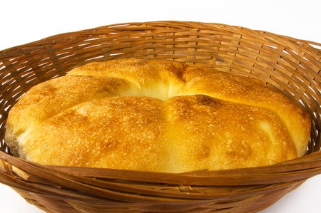 unleavened: unleavened wheat cake on a wicker plate