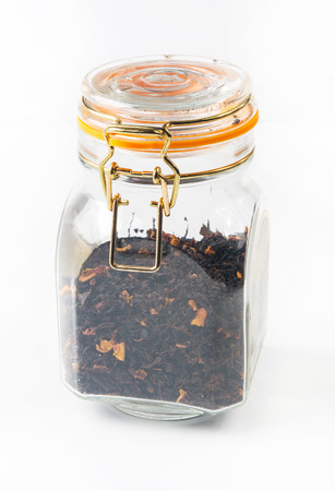sealed: black tea with blackberries, strawberries and rose petals in a sealed glass jar on white background