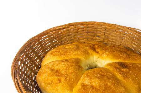 chubby rotund unleavened wheat cake on a wicker plate Stock Photo