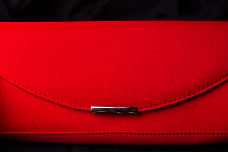closeup of the little womens handbag - clutch bag from red fabric Stock Photo