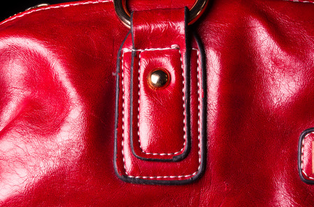seams: closeup of the seams on red leather hand bag Stock Photo