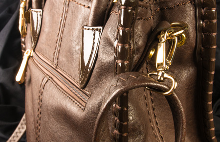 closeup of the seams on brown leather hand bag Stock Photo
