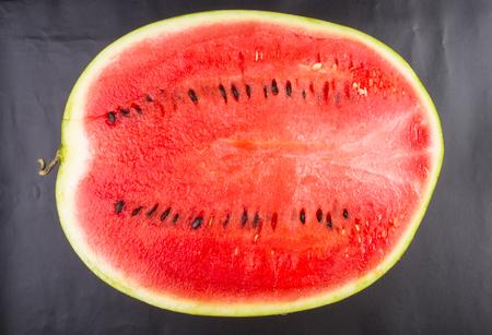 half of ripe watermelon on a black background Stock Photo