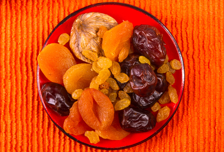 various dried fruits on the textile orange background Stock Photo
